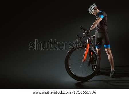 Spost background with copyspace. Cyclist. Dramatic colorful close-up portrait. Photo stock ©