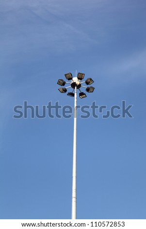Spot-light tower against the blue sky
