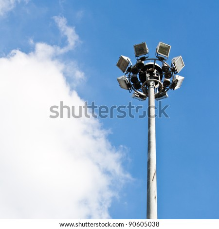 Spot-light tower in blue sky with cloud