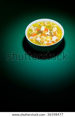 Spot of bright light on bowl of nice chicken soup