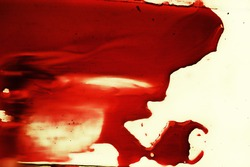 spot of red blood on white close up