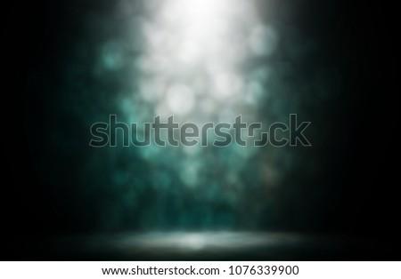 Spotlight bokeh blue smoke stage entertainment background. #1076339900