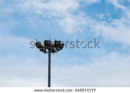 spotlight on pole with blue sky background #668814199