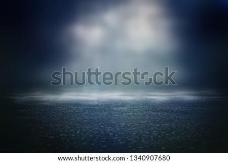 Spotlight over concrete floor. dark black background #1340907680