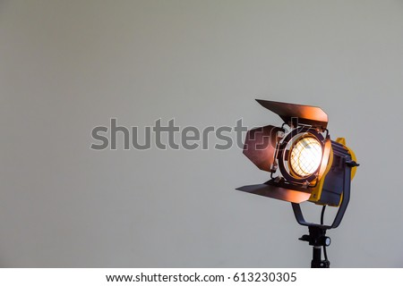 Spotlight with halogen bulb and Fresnel lens. Lighting equipment for Studio photography or videography. #613230305