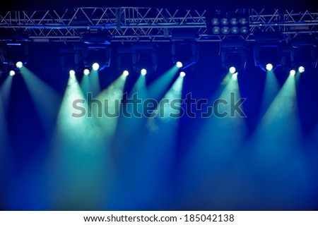 Spotlights and illumination equipment with fog on stage background #185042138