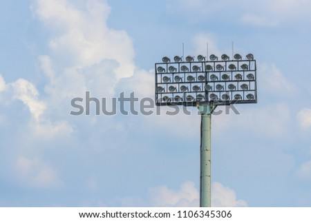 Spotlights on the football field have a sky background. #1106345306