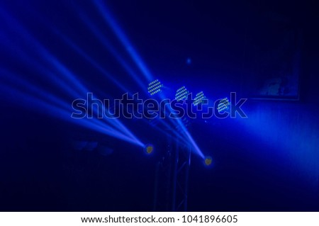 Spotlights, spotlights and effects from the stage. #1041896605