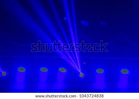 Spotlights, spotlights and effects from the stage. #1043724838