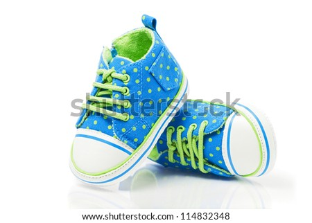 Spotted baby sneakers closeup isolated on white
