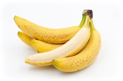 Spotted bananas. Ripened Cavendish bananas isolated on white with shadows