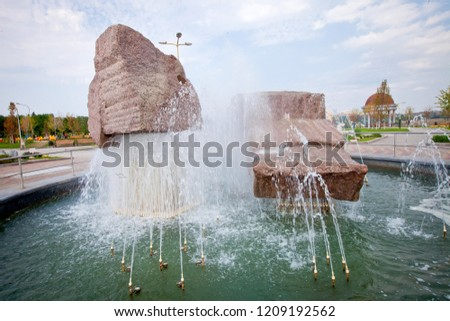 Spouting fountain with rocks, shot in Donetsk in the park near stadium, summer 2012 (day)