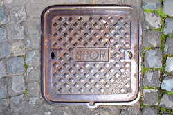 SPQR, typical manhole cover in the Rome streets, Italy