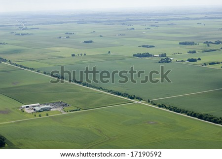 Sprawling green farmland seen from above.