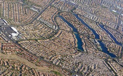 Sprawling suburban and commercial development in Las Vegas, Nevada is pushing up against the mountains in the western desert as the population increases