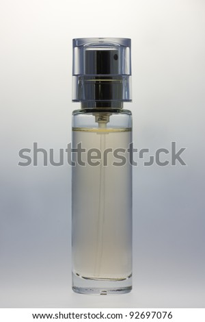 Spray with perfume. Vial of perfume.