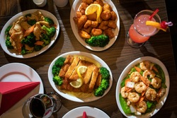 Spread of Chinese food on a table with drinks