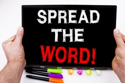 Spread The Word text written on tablet, computer in the office with marker, pen, stationery. Business concept for Announcement Business Marketing Message white background with copy space