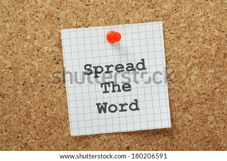 Spread the Word typed on a piece of graph paper and pinned to a cork notice board