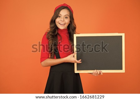 Spread your publicity. Happy kid hold blank blackboard for school publicity. Little child smile with tidy publicity board. Advertising and marketing. Publicity agency, copy space.
