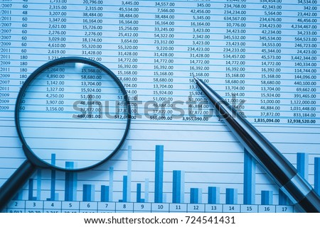 Spreadsheet bank accounts accounting finance forensics with magnifying glass and pen. Concept for financial fraud investigation, audit and analysis.