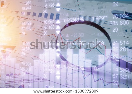 Spreadsheet bank accounts accounting with calculator and magnifying glass. Concept for financial fraud investigation, audit and analysis. Stock photo ©