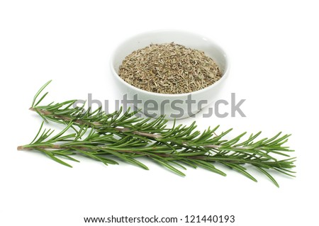 Sprig fresh rosemary and a bowl with dried rosemary