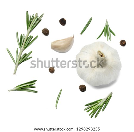 Sprigs and leaves of rosemary, allspice and garlic. White isolated background. View from above. #1298293255