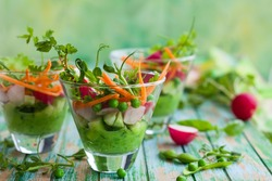 Spring appetizer with raw vegetables and green pea hummus