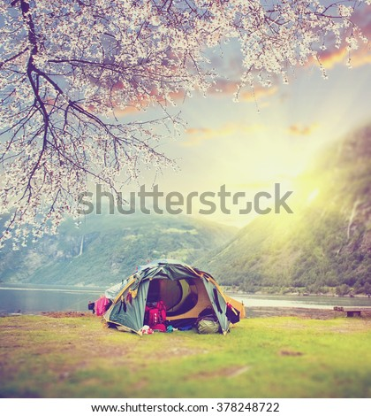 Spring at Norway camping. tourist tent in the Norway mountains at sunrise. Vintage colored picture