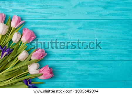 Spring background!A bouquet of tulips on a wooden background.Holiday greeting card for Valentine's Day, Woman's Day, Mother's Day, Easter!
