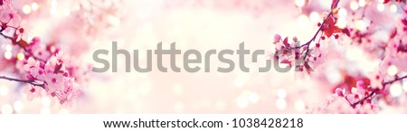 Spring border or background art with pink blossom. Beautiful nature scene with blooming tree and sun flare. Easter Sunny day. Spring flowers. Beautiful Orchard Abstract blurred background. Springtime #1038428218