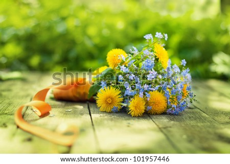 spring bouquet on wooden table