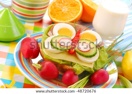 spring breakfast for child with butterfly shape sandwich - stock photo