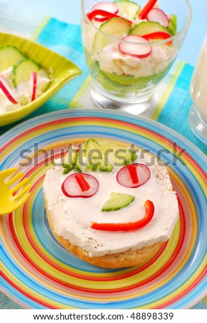 spring breakfast for child with funny face shape sandwich