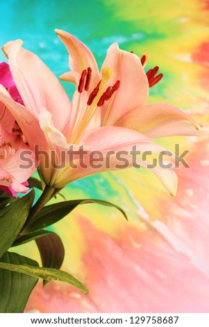 Spring bursts forth in explosion of color-- Easter flower arrangement featuring pink lilies against psychedelic colored background.