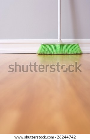 Spring Cleaning broom against wall