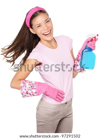 Spring cleaning. Cleaning woman pointing cleaning spray bottle happy and smiling. Beautiful cleaning girl isolated on white background. Mixed race Caucasian / Asian Chinese woman.