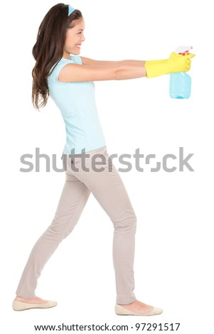 Spring cleaning. Cleaning woman pointing cleaning spray bottle in profile. Beautiful cleaning girl standing in full body isolated on white background. Mixed race Caucasian / Asian Chinese woman. - stock photo