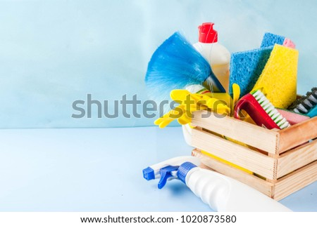 Spring cleaning concept with supplies, house cleaning products pile. Household chore concept, on light blue background copy space #1020873580