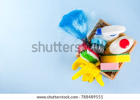 Spring cleaning concept with supplies, house cleaning products pile. Household chore concept, on light blue background copy space top view #788489551