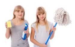 Spring cleaning - Sisters showing cleaning utensils isolated on white