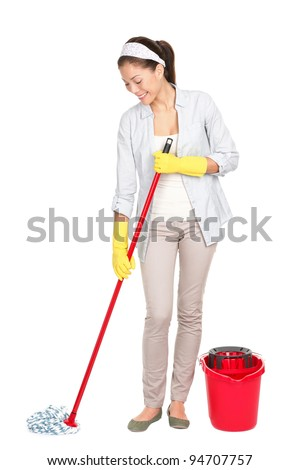 Spring cleaning woman cleaning floor with mop. Young housewife isolated on white background standing in full length. Chinese Asian / Caucasian model.