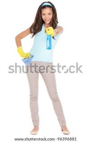 Spring cleaning woman pointing cleaning spray bottle. Beautiful cleaning girl standing in full body isolated on white background. Mixed race Caucasian / Asian Chinese woman having fun spring cleaning.
