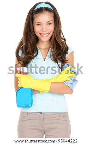 Spring cleaning woman ready for spring cleaning smiling with rubber gloves and cleaning products. Pretty smiling young mixed race Asian / Caucasian girl isolated on white background.