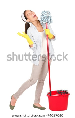 Spring cleaning woman singing fun using mop isolated on white background. Mixed race Caucasian and Asian young housewife having fun doing chores with cleaning mop and bucket for floor washing.