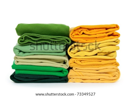 Spring colors. Fresh green and yellow laundry on white background.