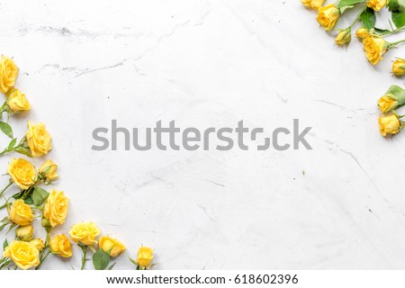 spring concept with flowers on white marble table background top view mockup #618602396