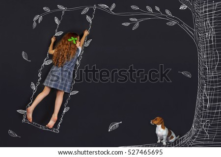 Shutterstock Spring curly girl on a swing. Hand drawing tree on a blackboard. Happy childhood concept.
