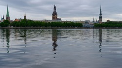 Spring, dawn over the Daugava on the background of old Riga